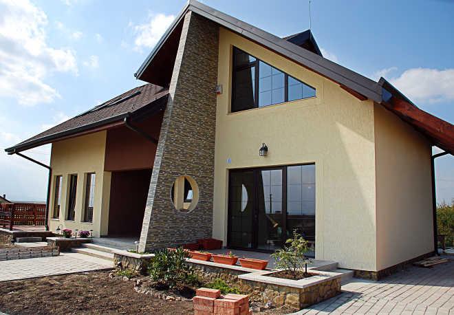 Каркасные загородные дома: преимущества и особенности